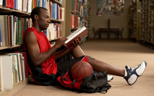 Basketball Player Studying in Library